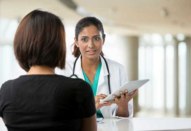 Doctor discussing something with a patient.